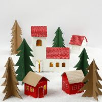 A Christmas village from milk/juice cartons and Christmas trees from recycled cardboard