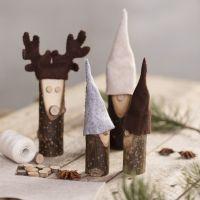 A nosy elf and a reindeer from wooden sticks