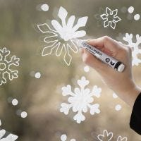 Snowflake window decoration with chalk markers