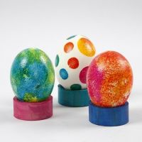 Painted natural Eggs on a Napkin Ring Stand