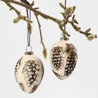 Terracotta Eggs with glued on Guinea Fowl Feathers
