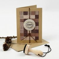 A Christmas Card with a Patchwork made from woven Paper Strips