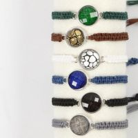 A braided Bracelet with a Cabochon in a Spacer Bead
