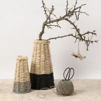 A tall woven Basket with a firm Base