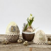 A two-part decoupaged Papier-Mâché Egg with Lace & Down Waistband