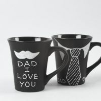 A black Mug with a white Graphic Design
