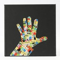 A black Canvas with a Silhouette Hand from patterned Masking Tape