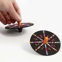 A painted Spinning Top decorated with Markers and Sequins