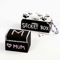 A painted Treasure Chest decorated with Rhinestones and Markers