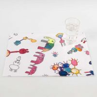 A Fabric Placemat with coloured-in Designs