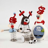 Silk Clay Christmas Figures on a coiled Spring