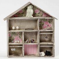 A House-shaped Shelving System with Decoupage and small Rails