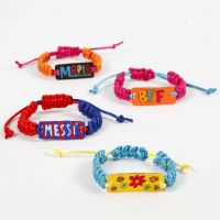 A braided Bracelet with a decorated Shrink Plastic Pendant