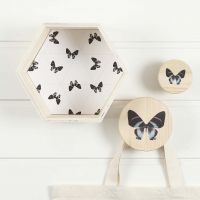 A hexagonal Bookcase and Hooks with matching decoration