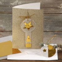 A Greeting Card with Glitter decorated with Gold and Vellum Paper