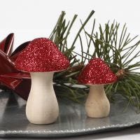A wooden Toadstool decorated with Glitter
