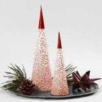 A Cone Christmas Tree placed over an LED Tealight