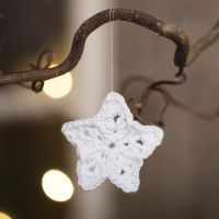 A small star crocheted from cotton yarn