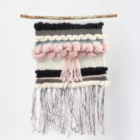 A woven Wall Hanging on a natural Stick