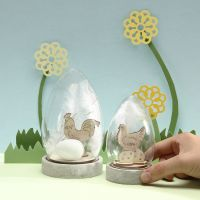 A Dome Bell Jar with self-assembly wooden Easter Figures, Eggs and white Feathers