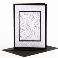 A Greeting Card with embossed Decoration and Wax Crayons