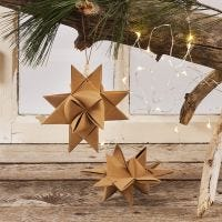 A Christmas Star woven from Faux Leather Paper Star Strips with a Leather Cord with wooden Beads for hanging