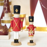 A wooden Nutcracker decorated with Plus Color