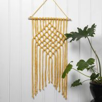 A braided Wall Hanging with Macramé from Cotton Tube Yarn