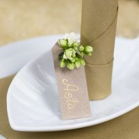 A Place Card from a Manilla Tag with a Flower for Decoration