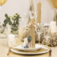 Gold Table Decorations with Paper Flowers, Balloons, a Napkin folded like a Tower and Place Cards