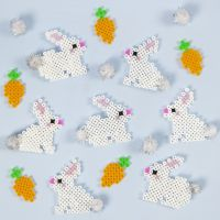 Easter Bunnies made from Nabbi Fuse Beads with Pom-pom Tails