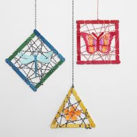 Hanging Decorations with wooden Construction Sticks and punched-out Summer Figures