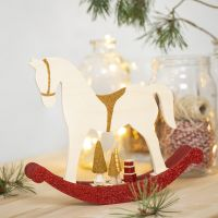 A Rocking Horse with small wooden Accessories deocrated with Craft Paint, Glitter and Beads