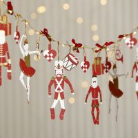 A Garland from LED Lights with Nutcracker Jumping Jacks and Bells