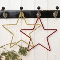 A crocheted Christmas Star on a Metal Star Frame