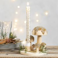 A Candlestick on a wooden Base with Toadstools decorated with mini Glass Beads