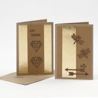 Greeting Cards decorated with punched-out Faux Leather Paper and a Pyrography Tool