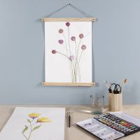 A purple Flower painted with Watercolours and hung with Poster Hangers