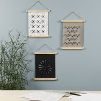 A Faux Leather Paper Wall Hanging decorated with a Pyrography Tool