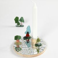 A Candlestick on a wooden Base with Mosaics