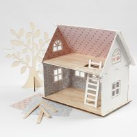 A dolls house plastered with design paper and ice lolly sticks for the floor