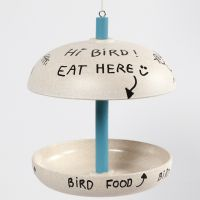 A bird table from bamboo fibres decorated with Plus Color craft paint