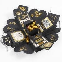 An explosion box as a present with money and chocolate