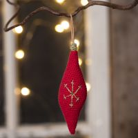 An oblong Christmas hanging decoration crocheted from cotton yarn