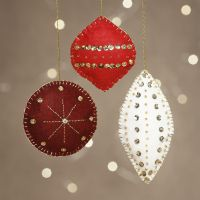 Felt Christmas decorations with beads and embroidery