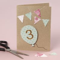 A birthday card with sewn-on details