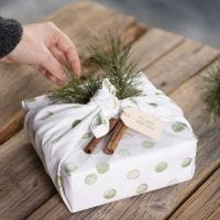 Gift wrapping with a tea towel decorated with a stamped design