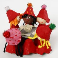 Elves around a table made from egg trays