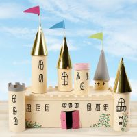 A fairytale castle from a cardboard box and cardboard tubes decorated with craft paint