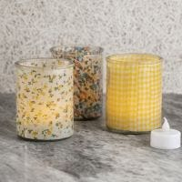 Candle holders decorated with fabric on the inside
